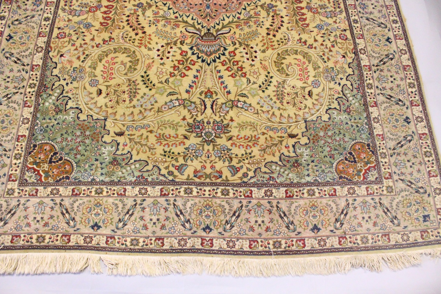 Lot 1031 - A GOOD PERSIAN CARPET, 20TH CENTURY, beige ground with central floral panel within a similar border.