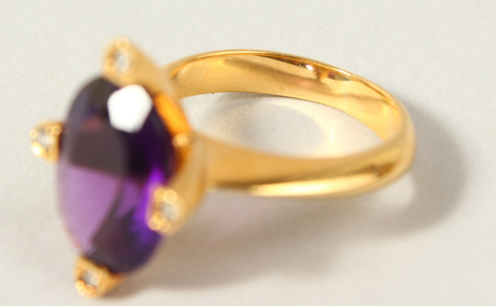 Lot 1743 - A 14K GOLD, AMETHYST AND DIAMOND RING.
