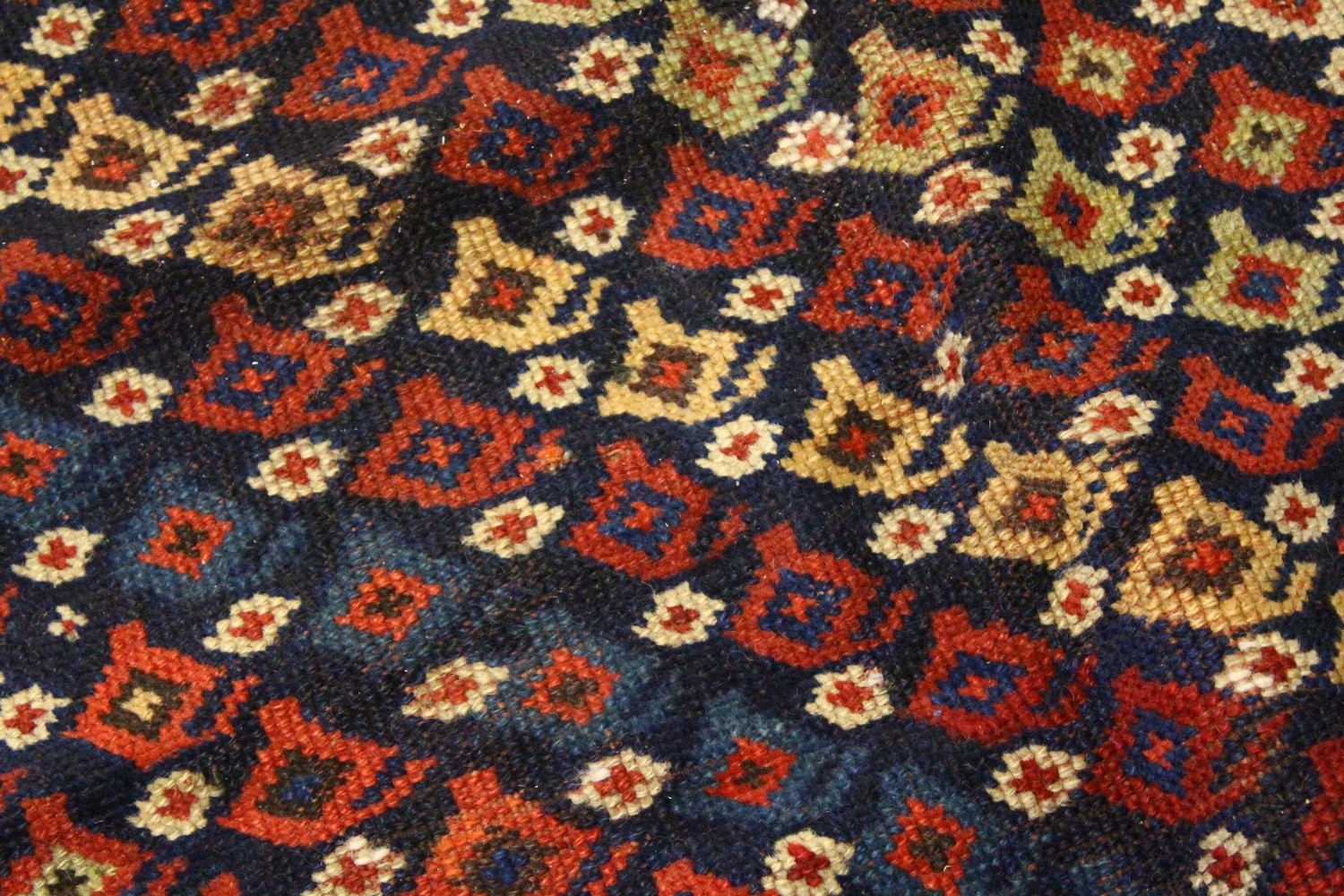Lot 1034 - A GOOD CAUCASIAN CARPET with a centre with numerous designs within a four row border. 12ft x 4ft