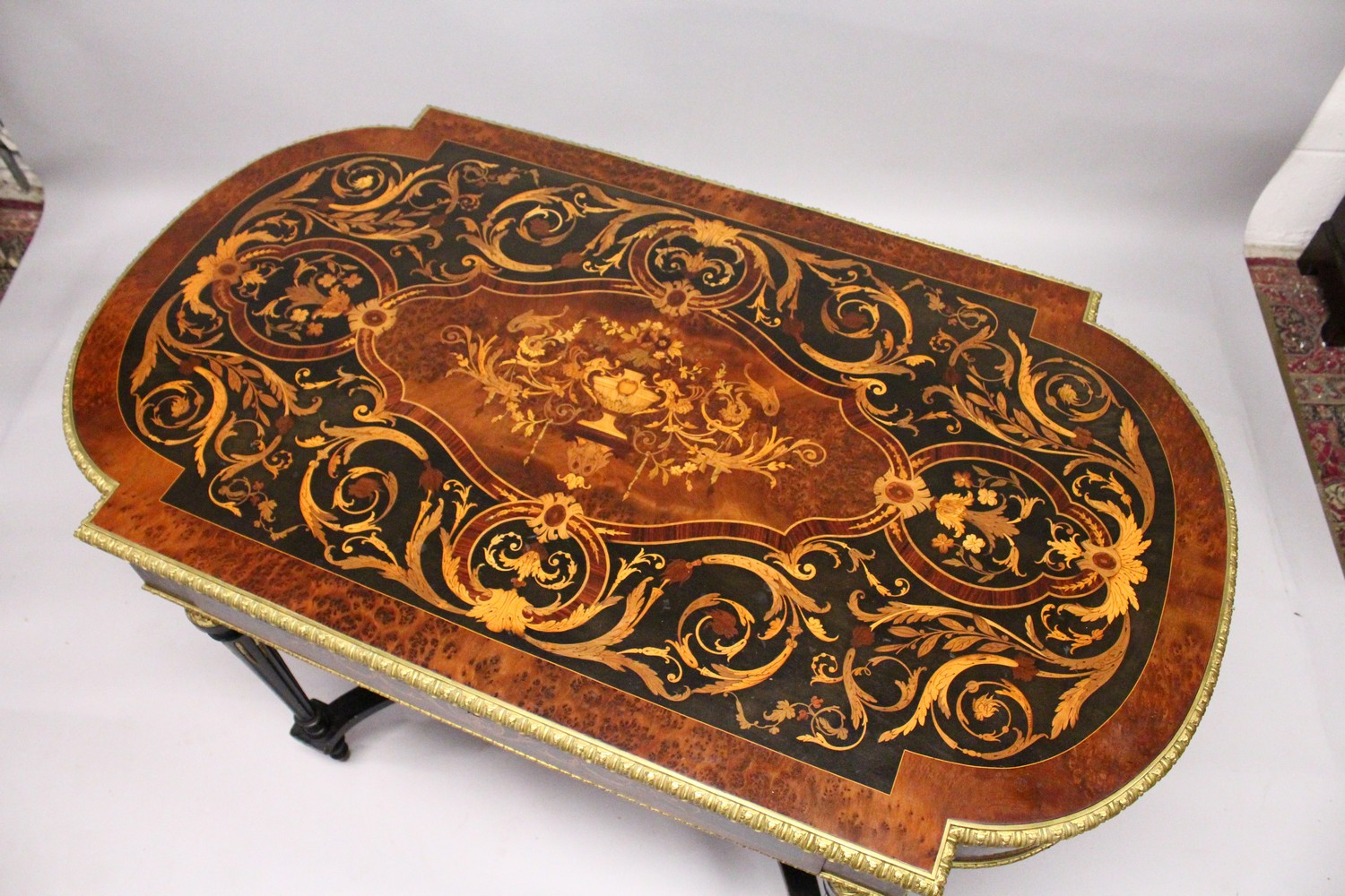 Lot 1007 - A GOOD FRENCH MARQUETRY AND ORMOLU CENTRE TABLE, with rounded ends, the top inlaid with exotic woods