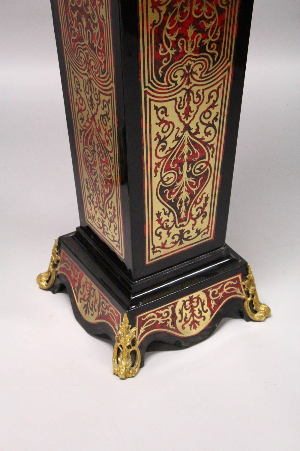 Lot 1025 - A PAIR OF BOULLE STYLE TAPERING SQUARE COLUMNS, with ormolu mounts. 4ft 0ins high.