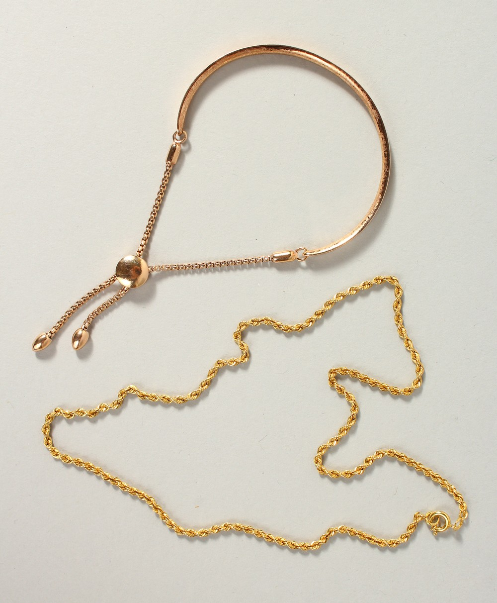 Lot 1749 - A 9CT GOLD BRACELET AND CHAIN, 22gms.