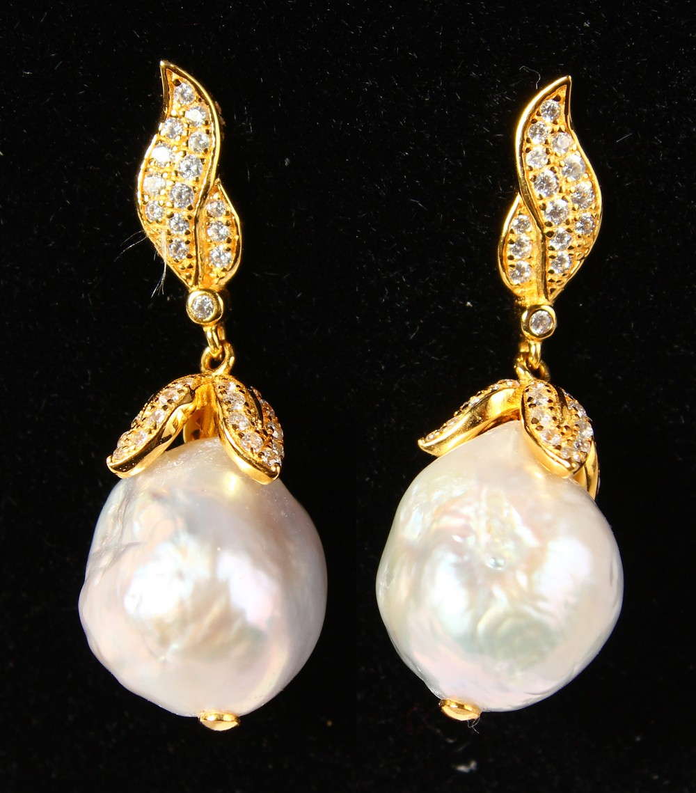 Lot 1757 - A PAIR OF SILVER AND BAROQUE PEARL EARRINGS.