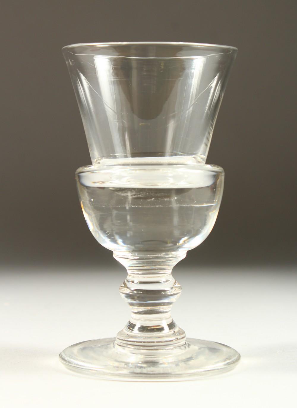 Lot 1047 - A GOOD TRUMPET SHAPED PLAIN GLASS on a large circular base. 7ins high.