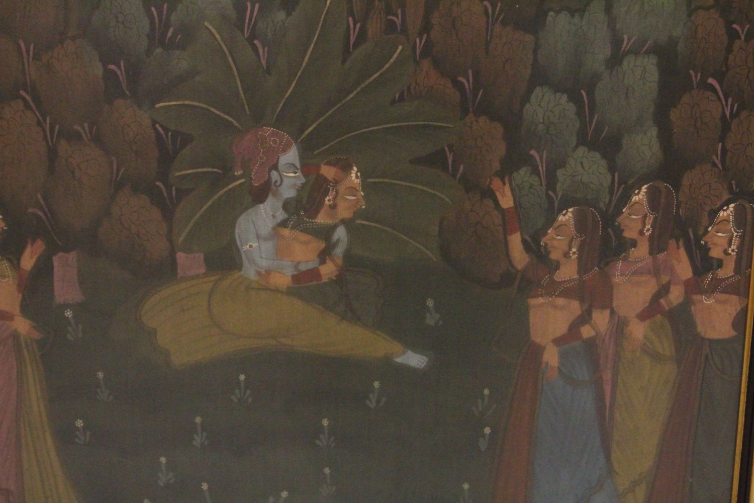 Lot 45 - A 19TH-20TH CENTURY FRAMED INDIAN PAINTING ON TEXTILE depicting a blue skin god dancing with a