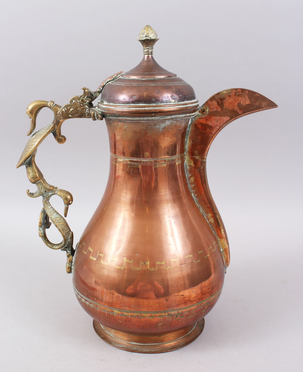 Lot 18 - A LARGE 19TH CENTURY INDIAN KASHMIR COFFEE POT with unusual double duck handle.