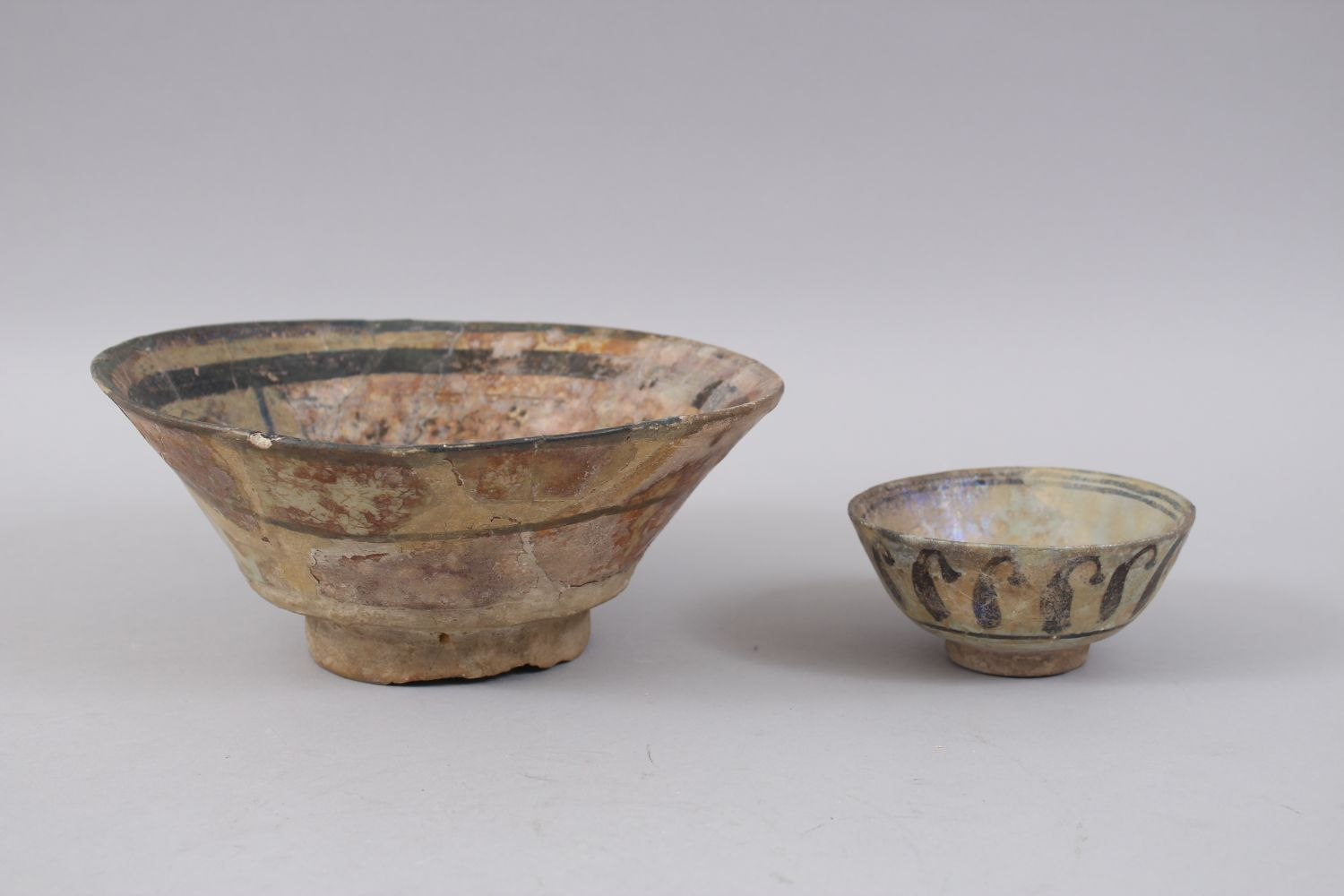 Lot 26 - TWO 12TH CENTURY SYRIAN RAQQA POTTERY BOWLS, the larger bowl with a figure in the centre 22cm