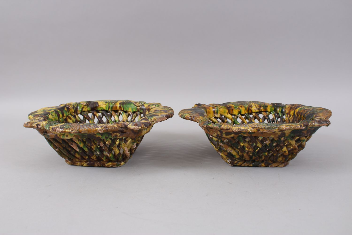 Lot 29 - A RARE PAIR OF 19TH CENTURY TURKISH OTTOMAN CANAKKALE POTTERY PIERCED YELLOW GROUND BASKETS, 25cm