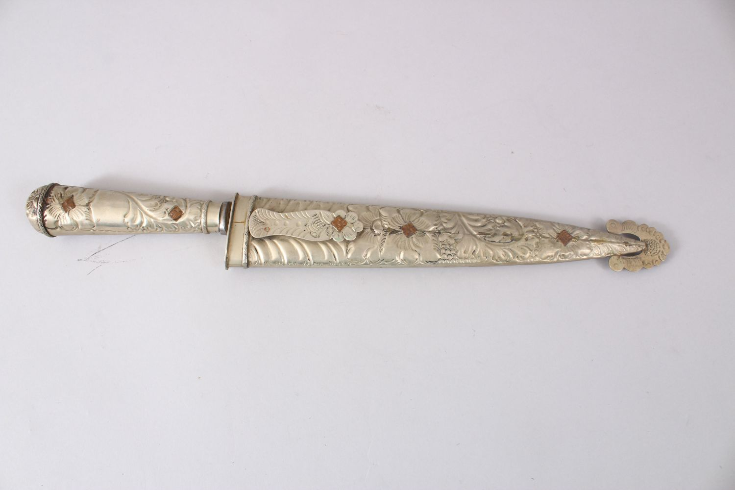 Lot 5 - A GOOD PERSIAN DAGGER, the sheath and handle formed from white metal in floral style, 42cm long