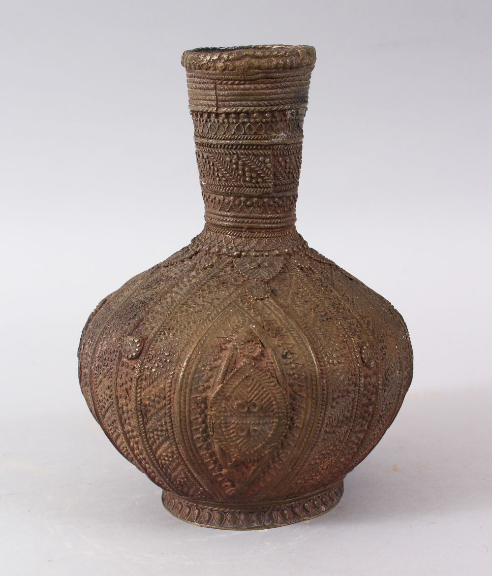 Lot 8 - A SMALL 19TH / 20TH CENTURY PERSIAN BRONZE VASE, the body with carved decoration, 19cm high.