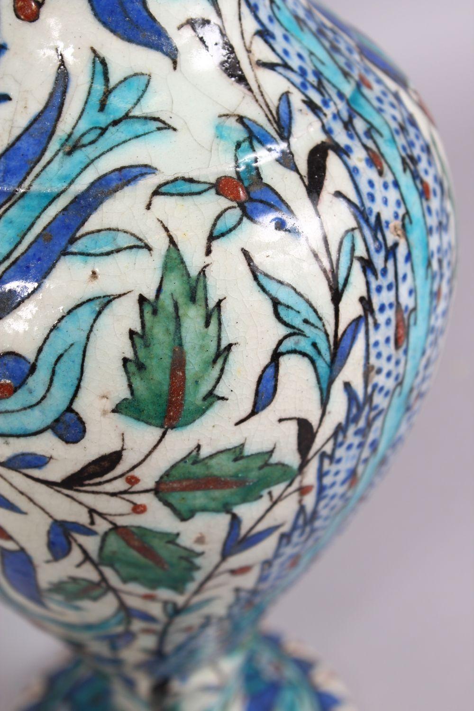 Lot 27 - THREE 19TH CENTURY OTTOMAN TURKISH KUTAHIYA VASES, large vase 32cm high, pair of vases 26cm high.