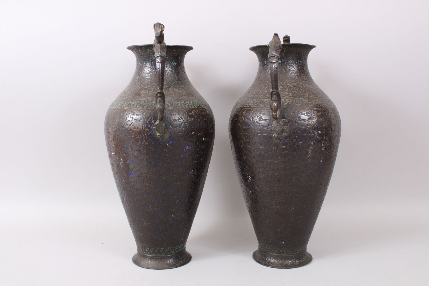 Lot 33 - A PAIR OF LARGE 19TH CENTURY INDIAN KASHMIRI ENAMELLED COPPER TWIN HANDLED VASES.