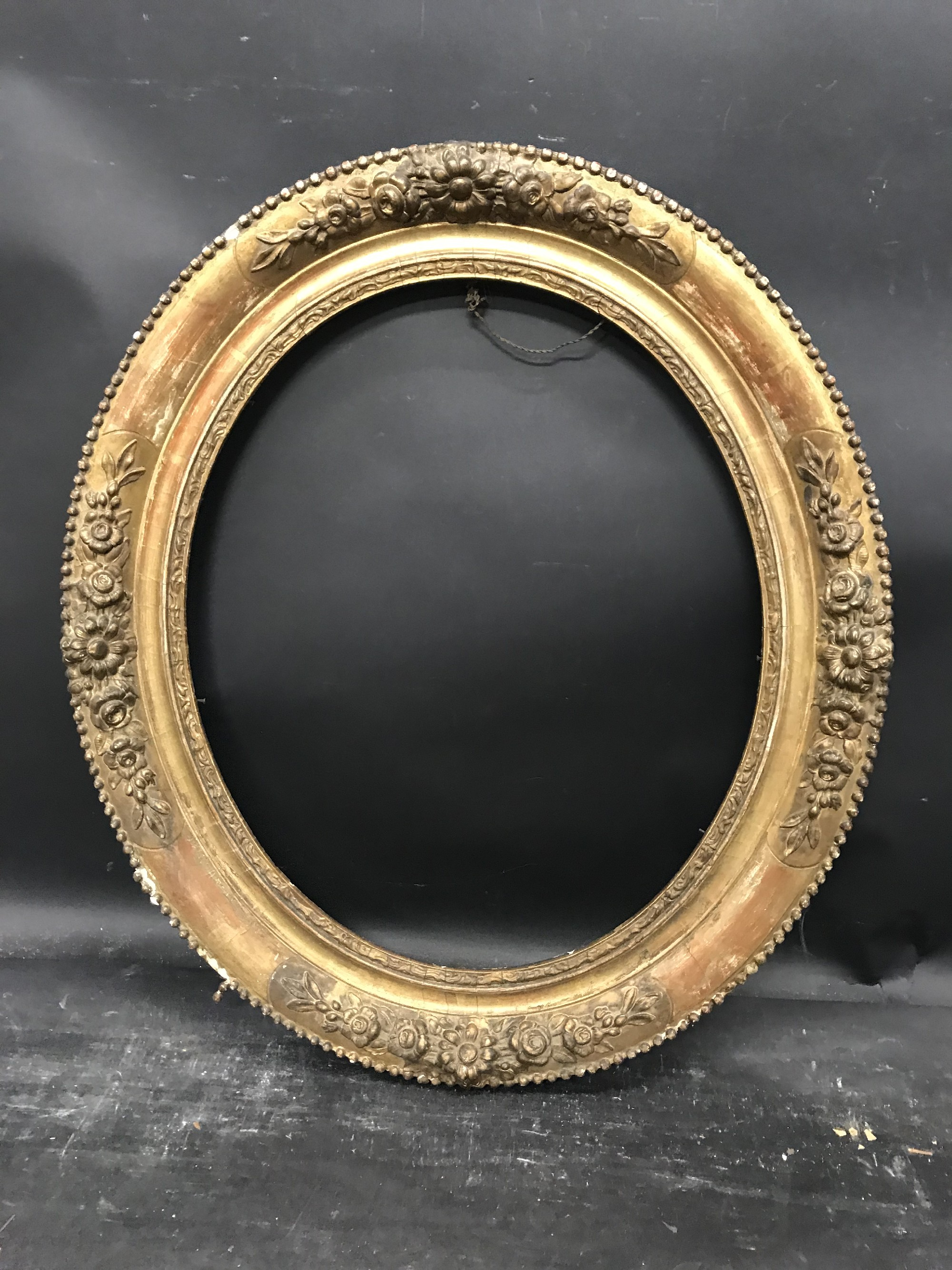"Lot 40 - 19th Century French School. An Oval Gilt Composition Frame, 18"" x 15""."