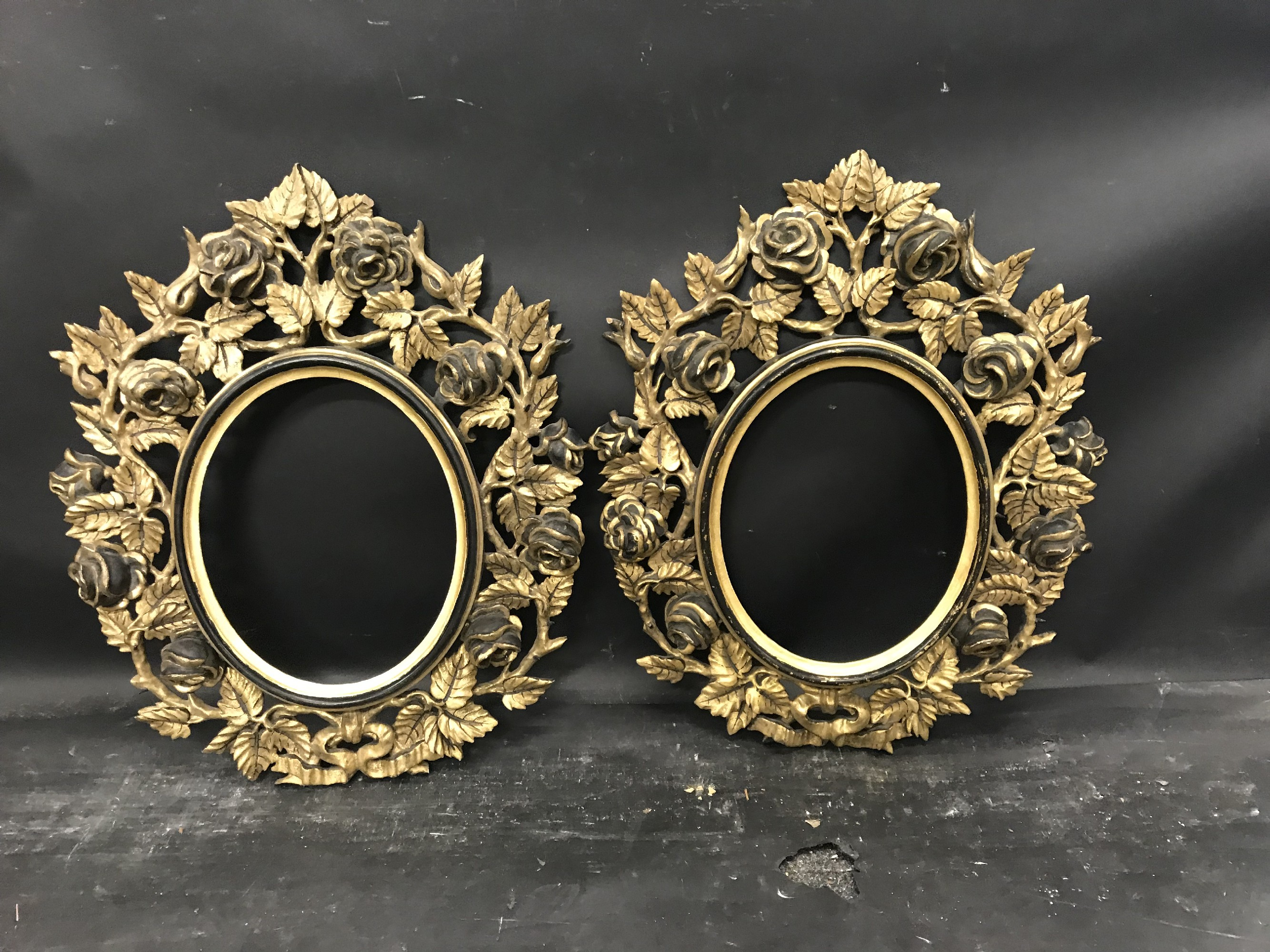 """Lot 49 - 19th Century Italian School. A Carved Giltwood and Black Painted Carved Frame, Oval, 10.5"""" x 8.5"""","""