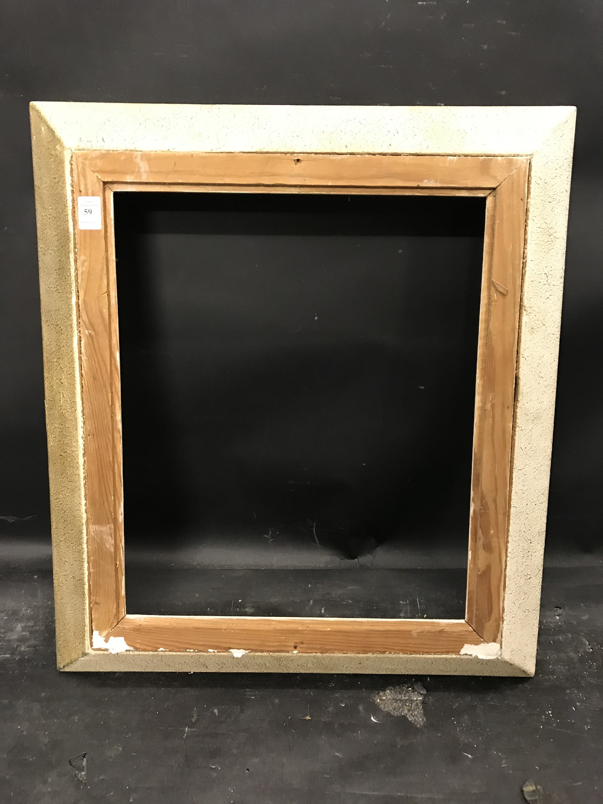 "Lot 59 - 20th Century French School. A White Painted Frame, 18"" x 15""."