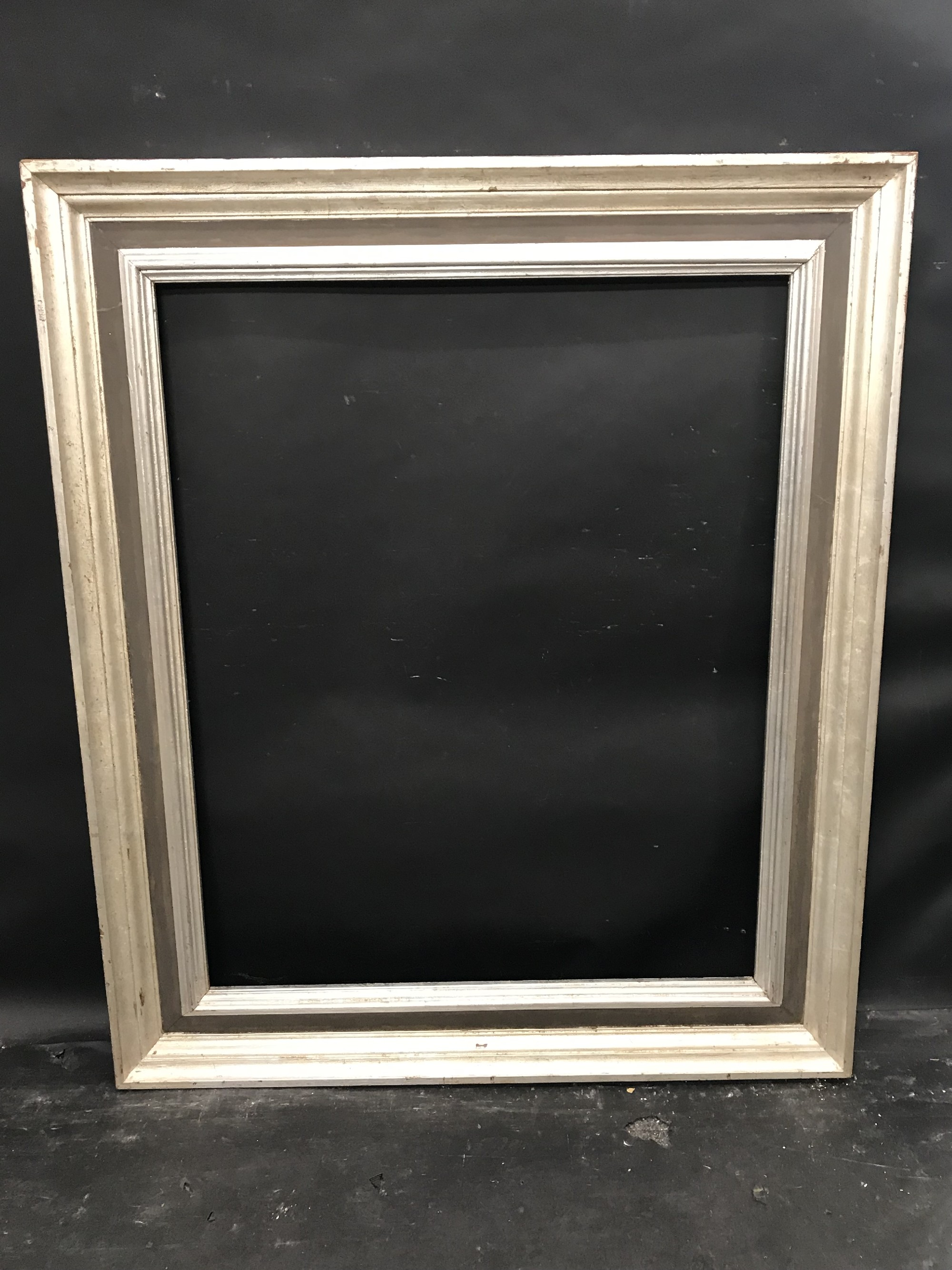 """Lot 23 - 20th Century English School. A Painted Silver and Black Frame, 37"""" x 29.75""""."""
