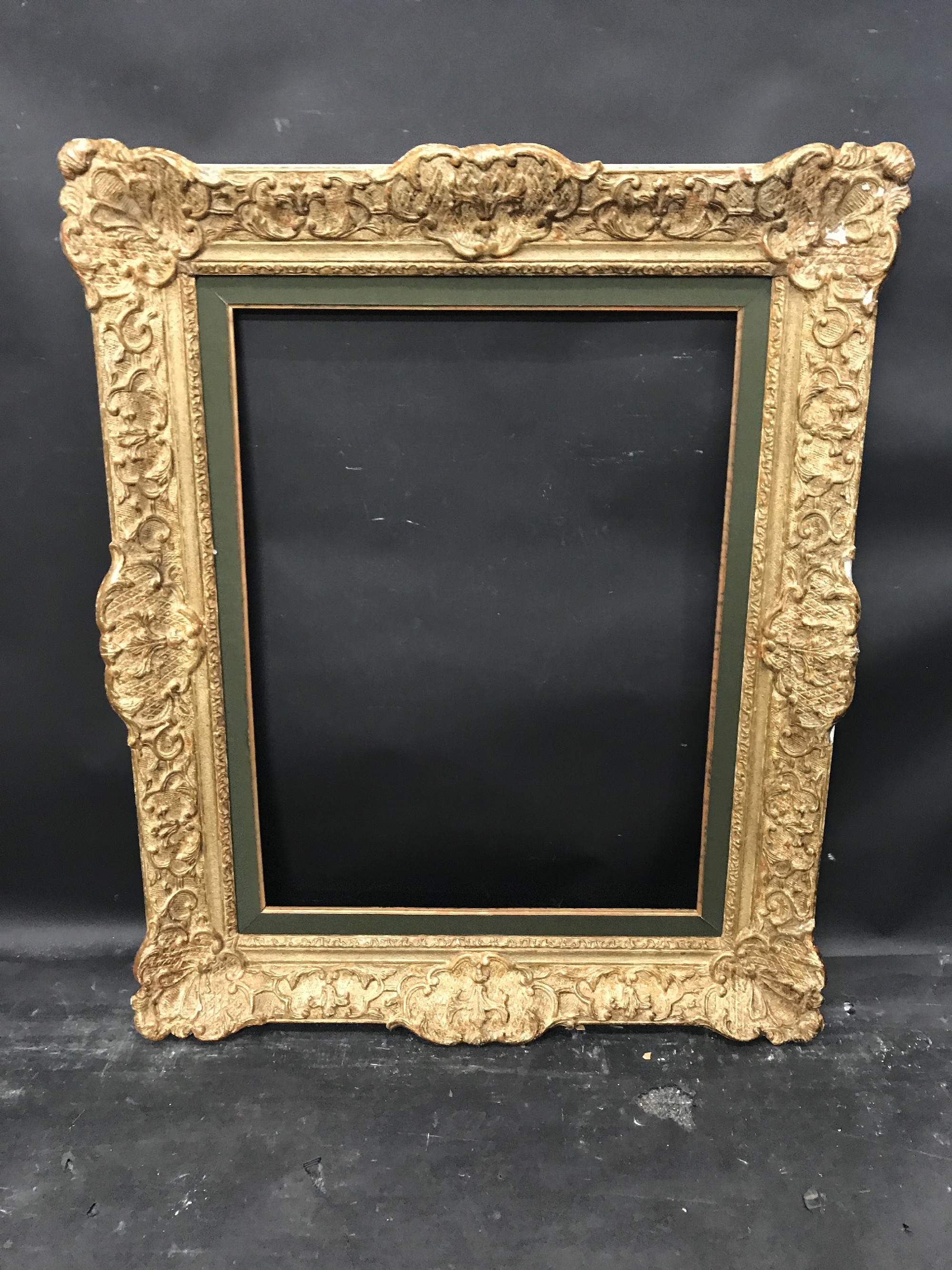 "Lot 27 - 20th Century French School. A Gilt and Painted Composition Frame, with Inset Fabric slip, 25.25"" x"