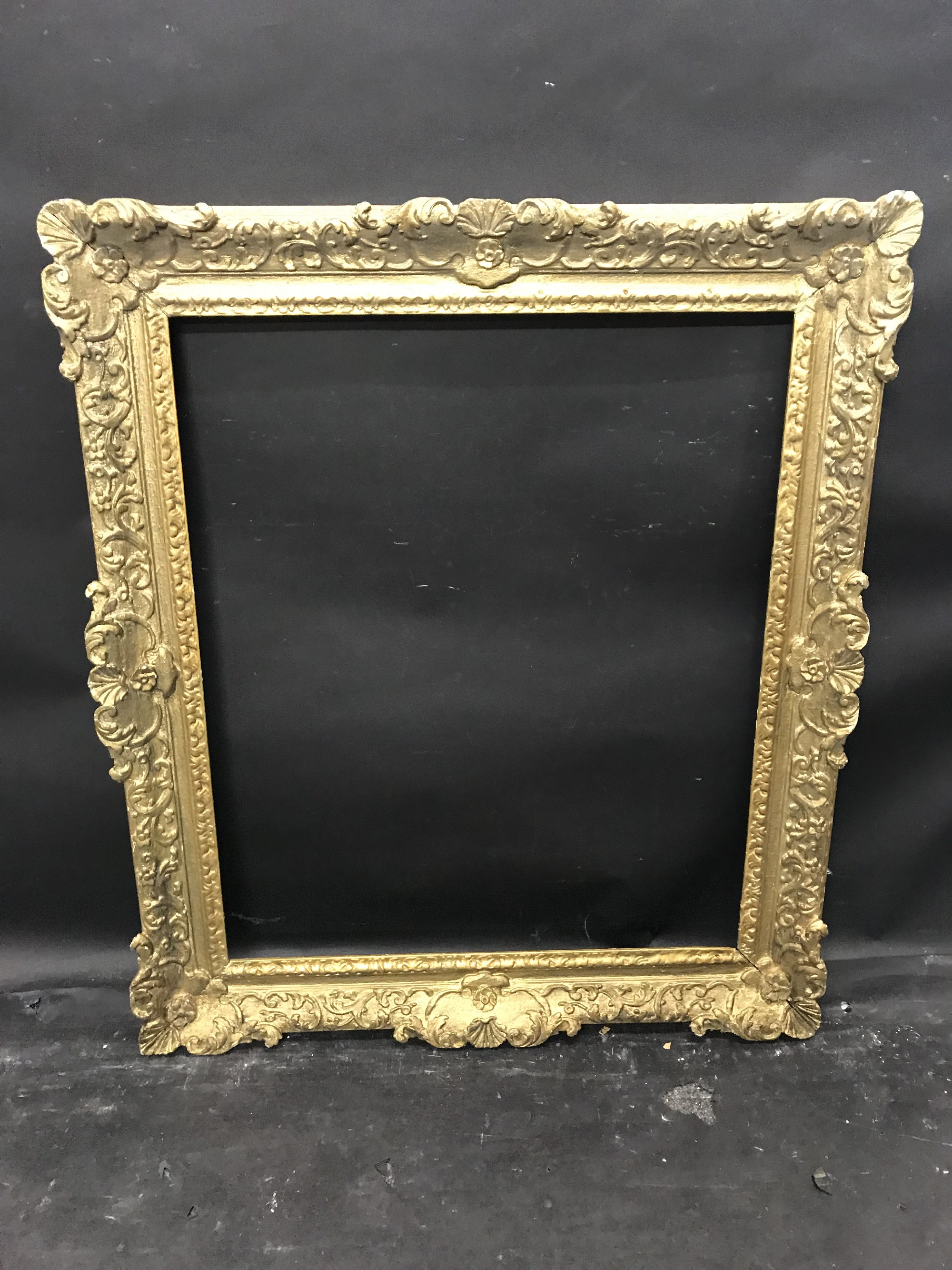 """Lot 21 - 19th Century English School. A Carved Giltwood Frame, with Swept Centers and Corners, 30"""" x 25""""."""