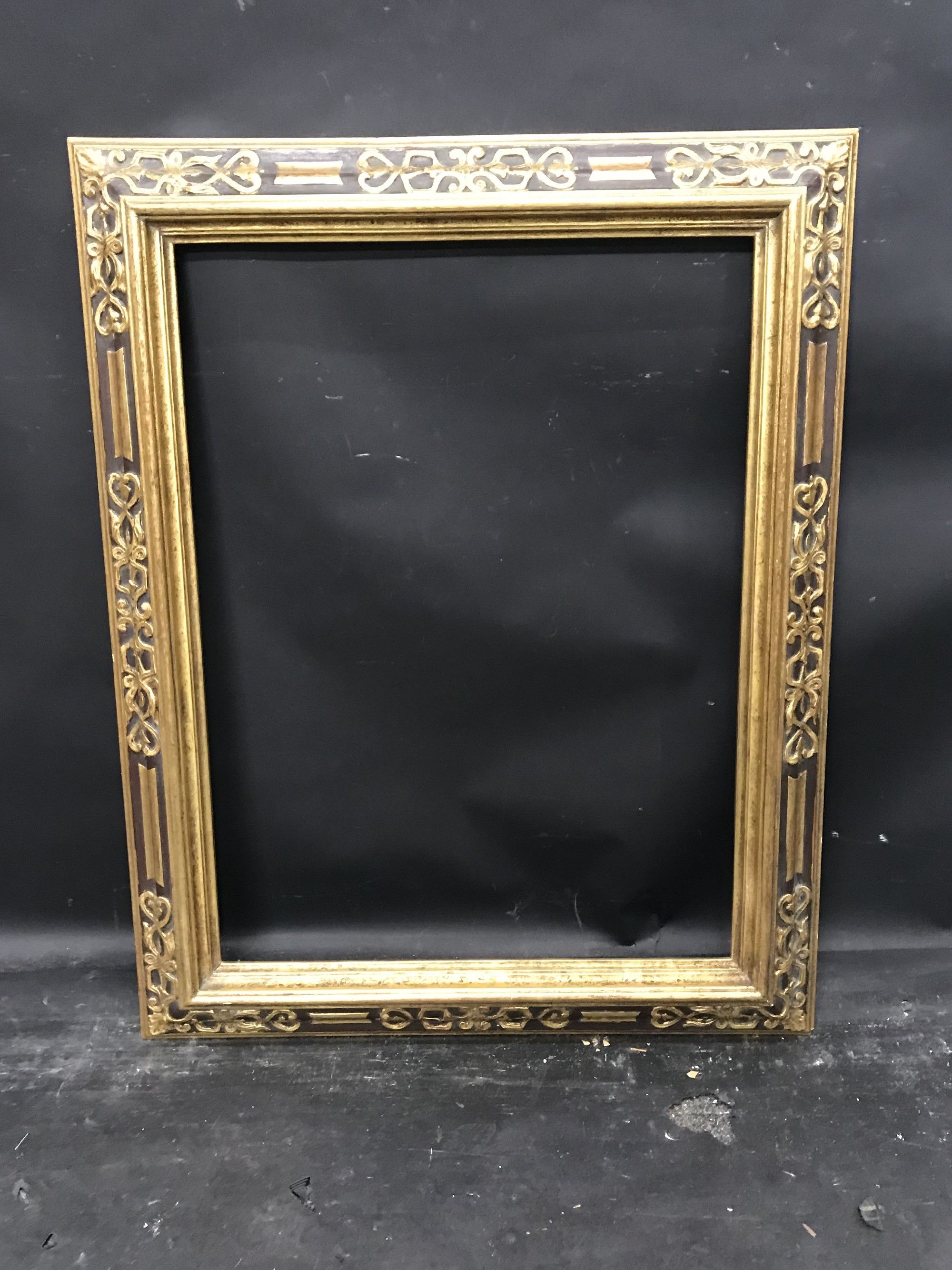 """Lot 44 - 20th Century Spanish School. A Gilt and Black Painted Frame, 26"""" x 19.25""""."""
