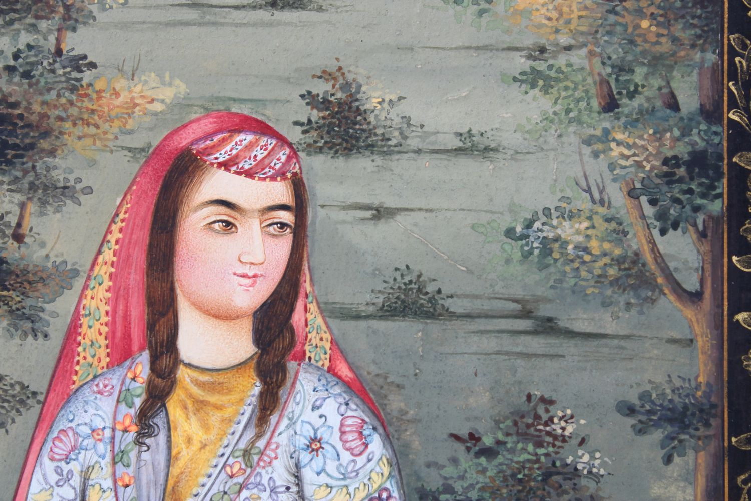 Lot 172 - A GOOD IRANIAN PAINTING, of a young woman, sitting crossed legged, 40cm x 30cm.