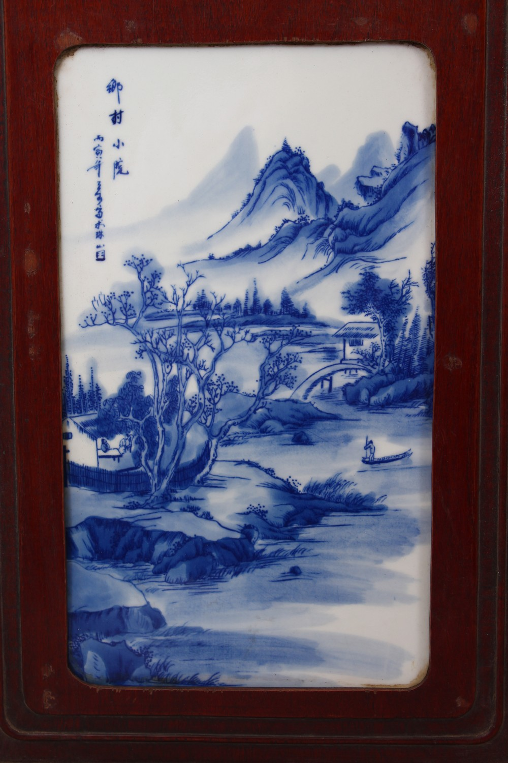 Lot 675 - A GOOD LARGE PAIR OF CHINESE BLUE & WHITE HARDWOOD FRAMED PORCELAIN PANELS, each panel inset with