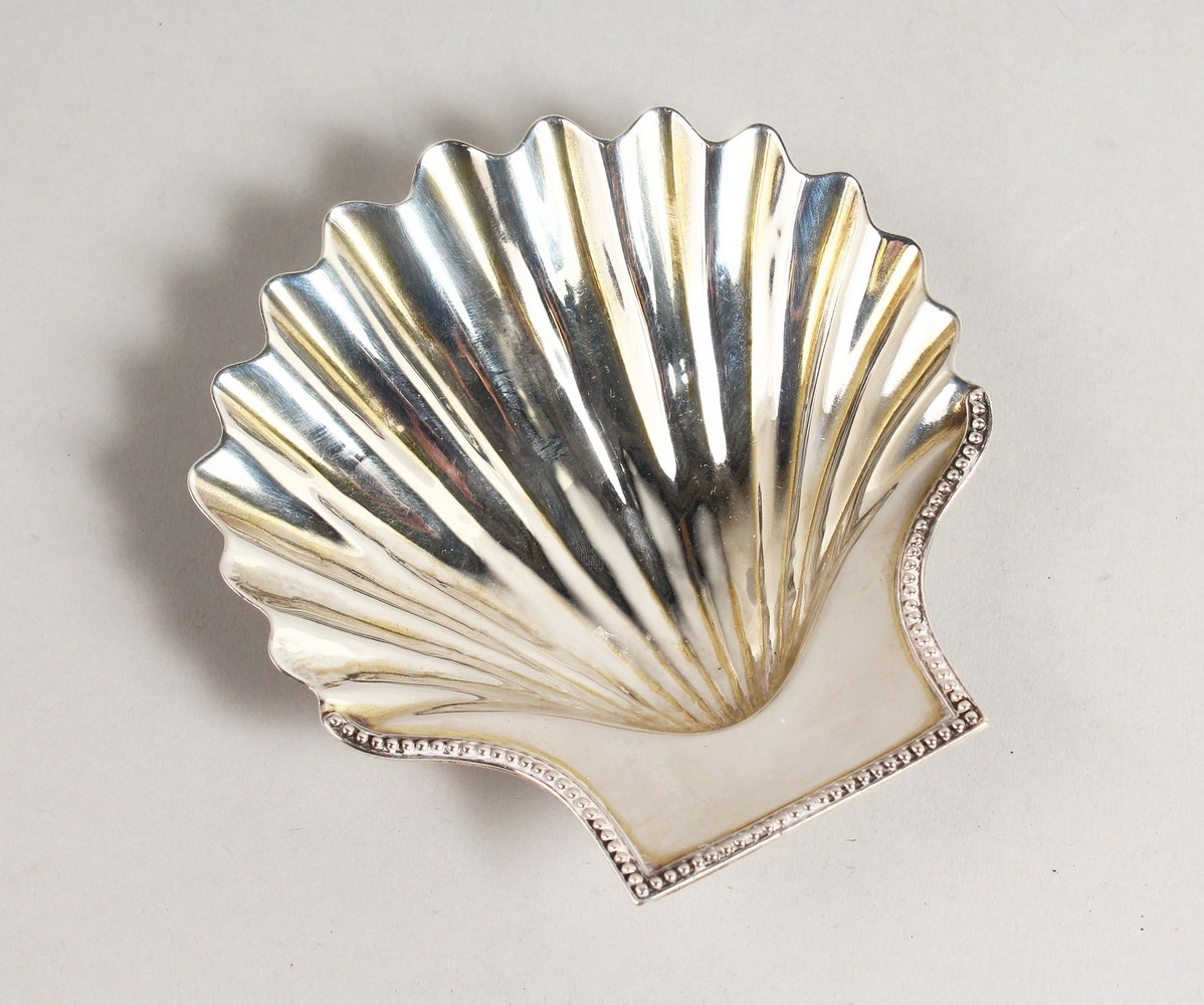 Lot 2090 - A GEORGE III SHELL SHAPED BUTTER DISH. London 1781.