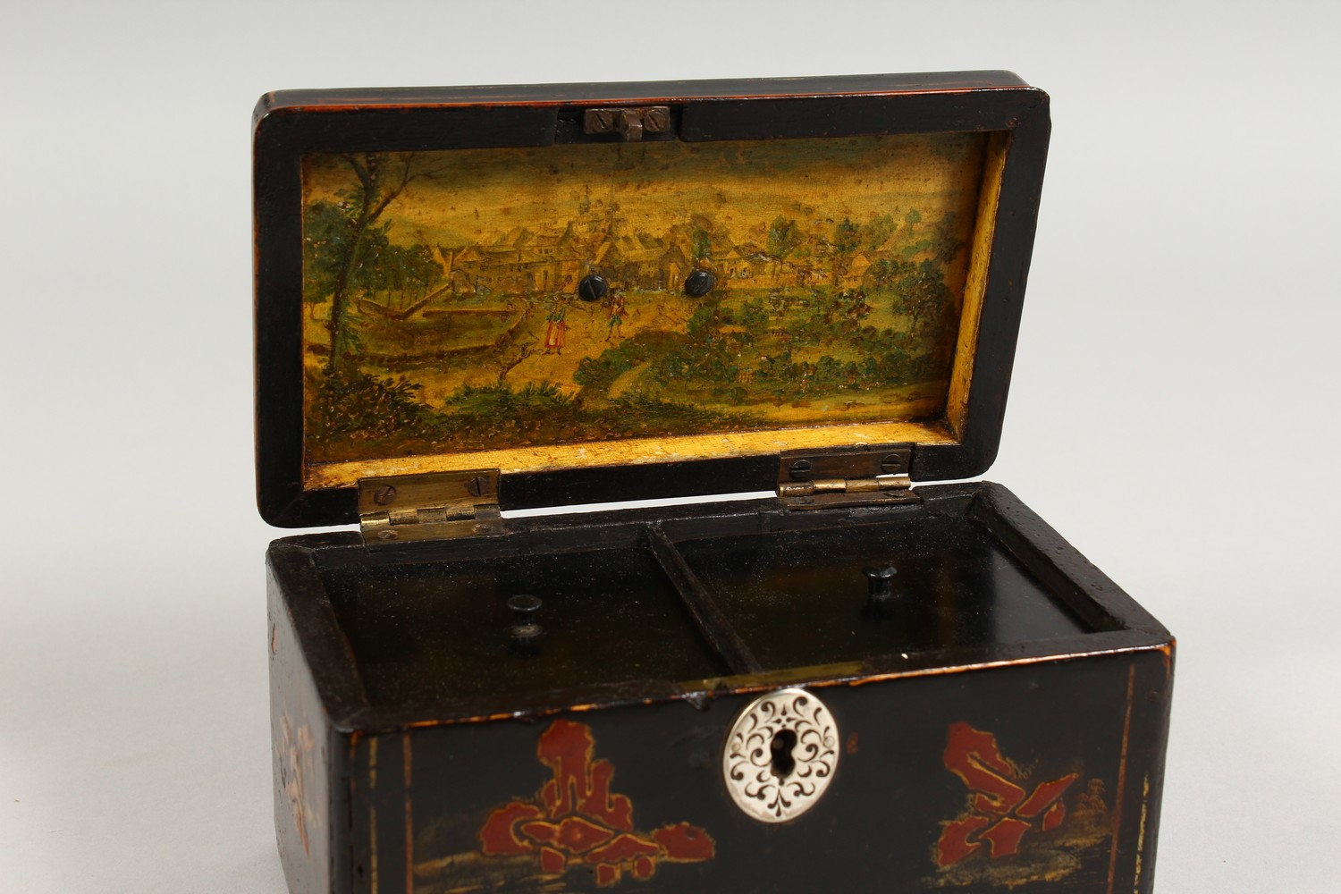 Lot 1568 - A REGENCY BLACK LACQUER TEA CADDY, with hinged lid and two divisions with Oriental design. 6.5ins.