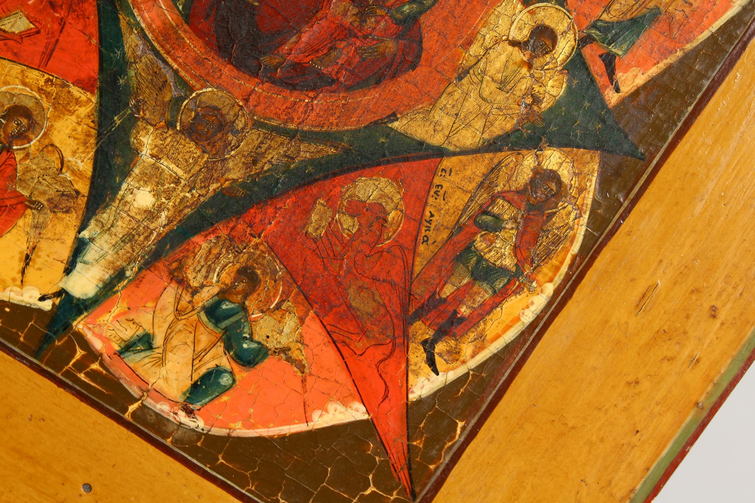 Lot 1714 - AN EARLY RUSSIAN ICON, on wooden panel. Madonna and Angels. 12ins x 11ins.