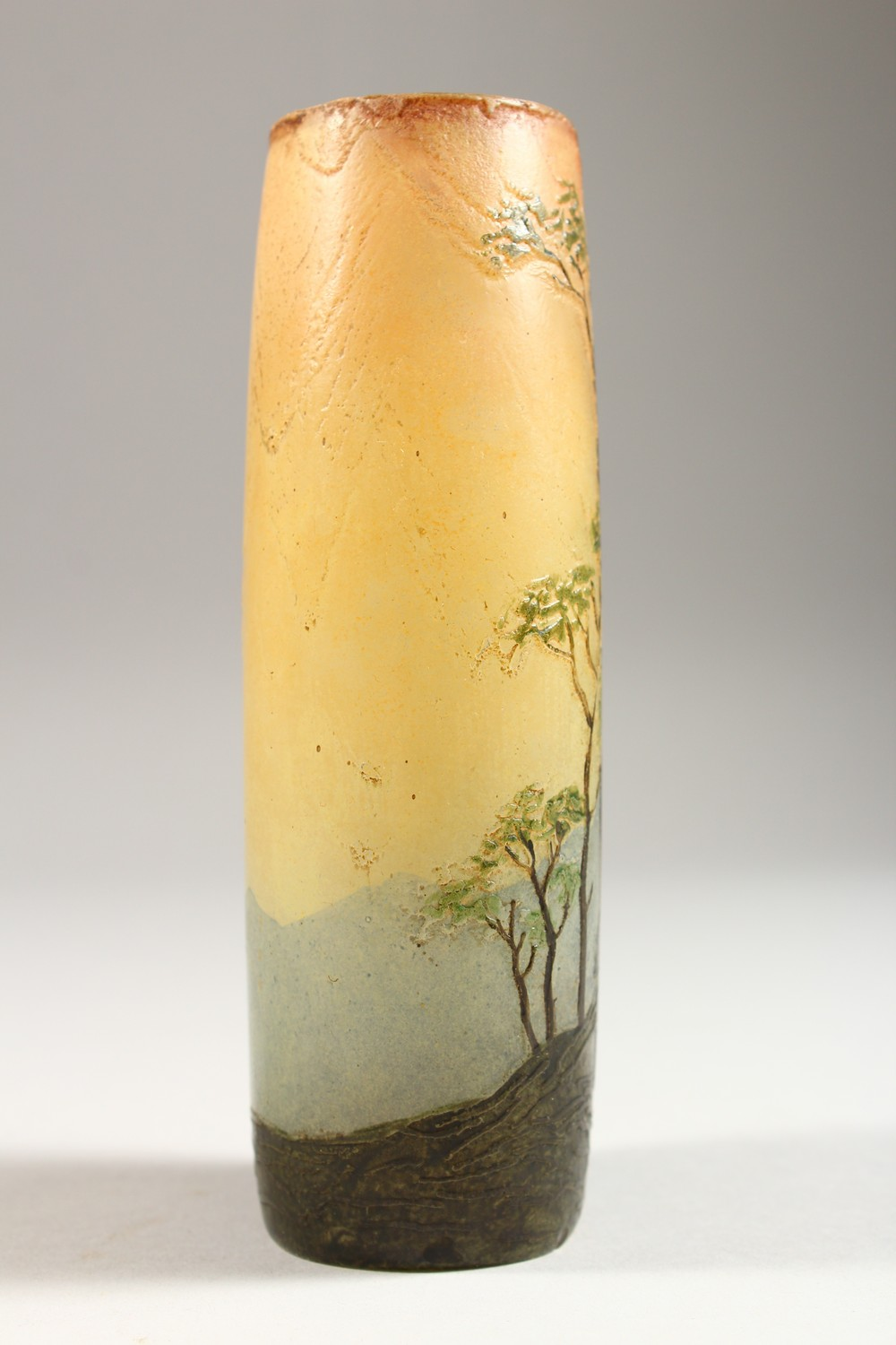 Lot 1081 - LEGRAS A GOOD CAMEO GLASS VASE, shepherdess with sheep on a hilltop with trees. Signed. 6ins high.