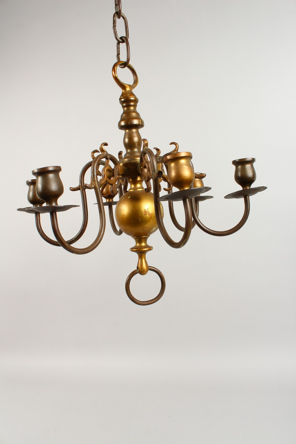 Lot 1496 - A SMALL DUTCH BRONZE SIX BRANCH CHANDELIER. 14ins high.
