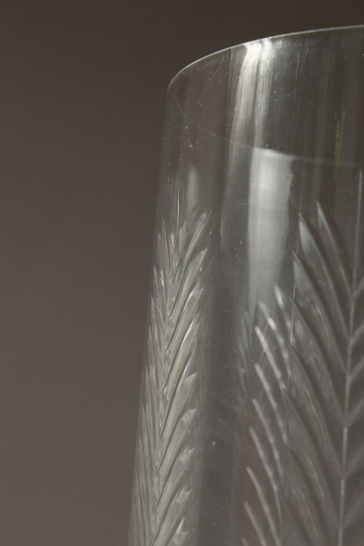 Lot 1084 - A PAIR OF CUT GLASS STORM LANTERNS. 16ins high.