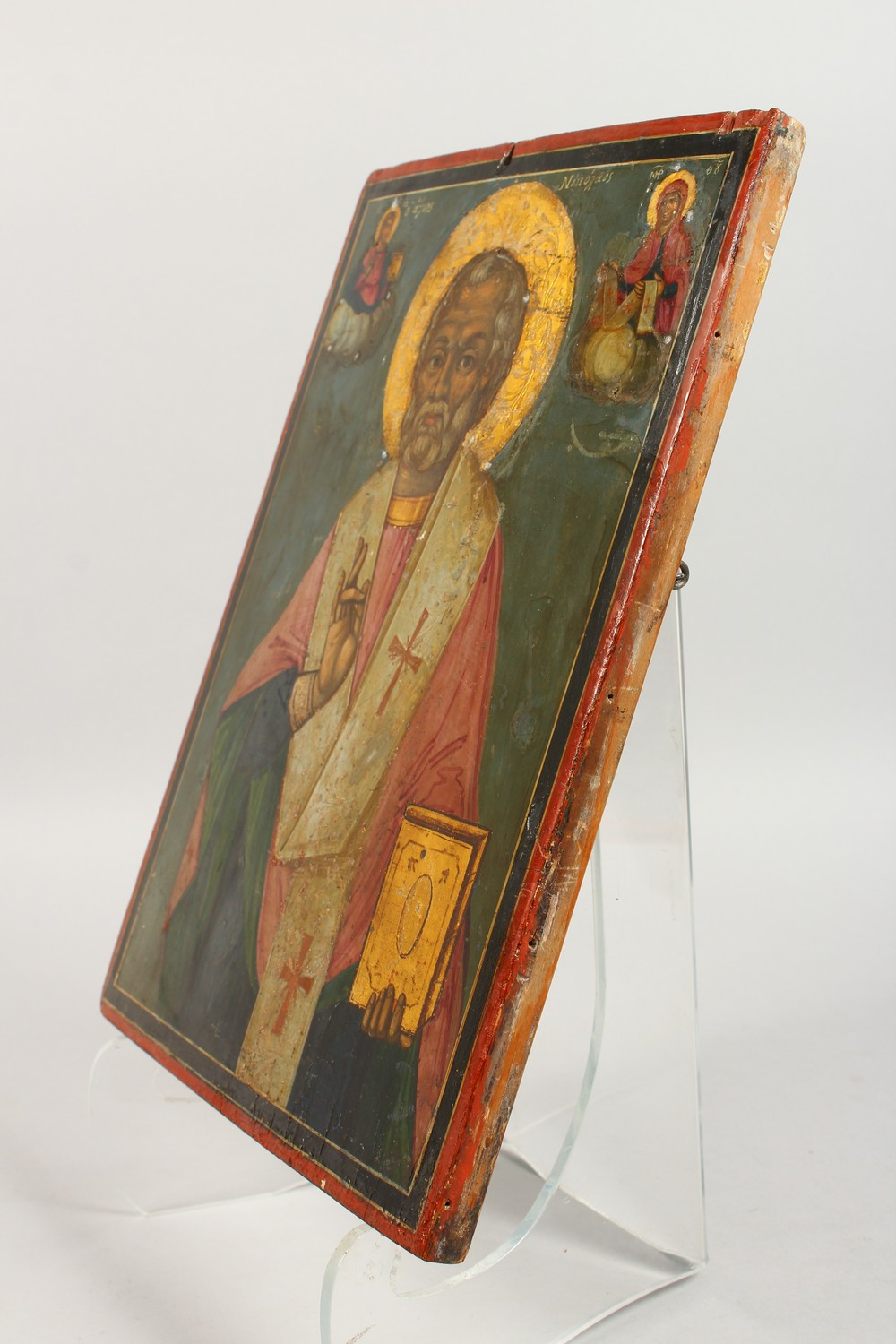 Lot 1712 - AN EARLY RUSSIAN ICON, on a wooden panel. Priest, dated 1853. 14ins x 11ins.