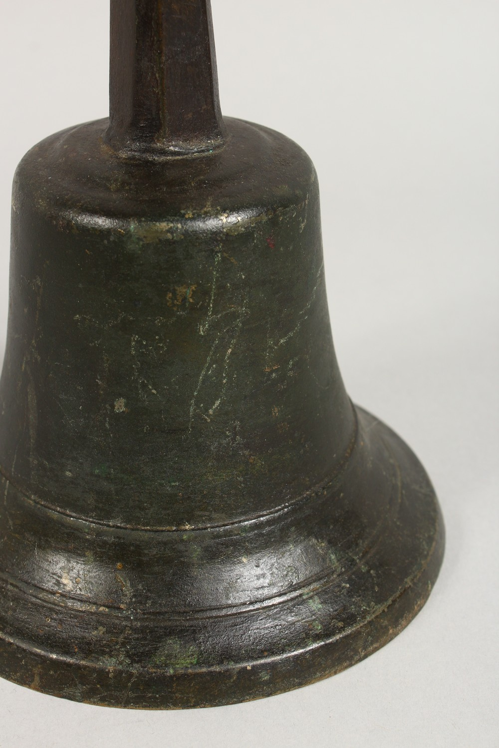 Lot 1493 - AN OLD HAND BELL, with wrought iron handle. 10ins high.