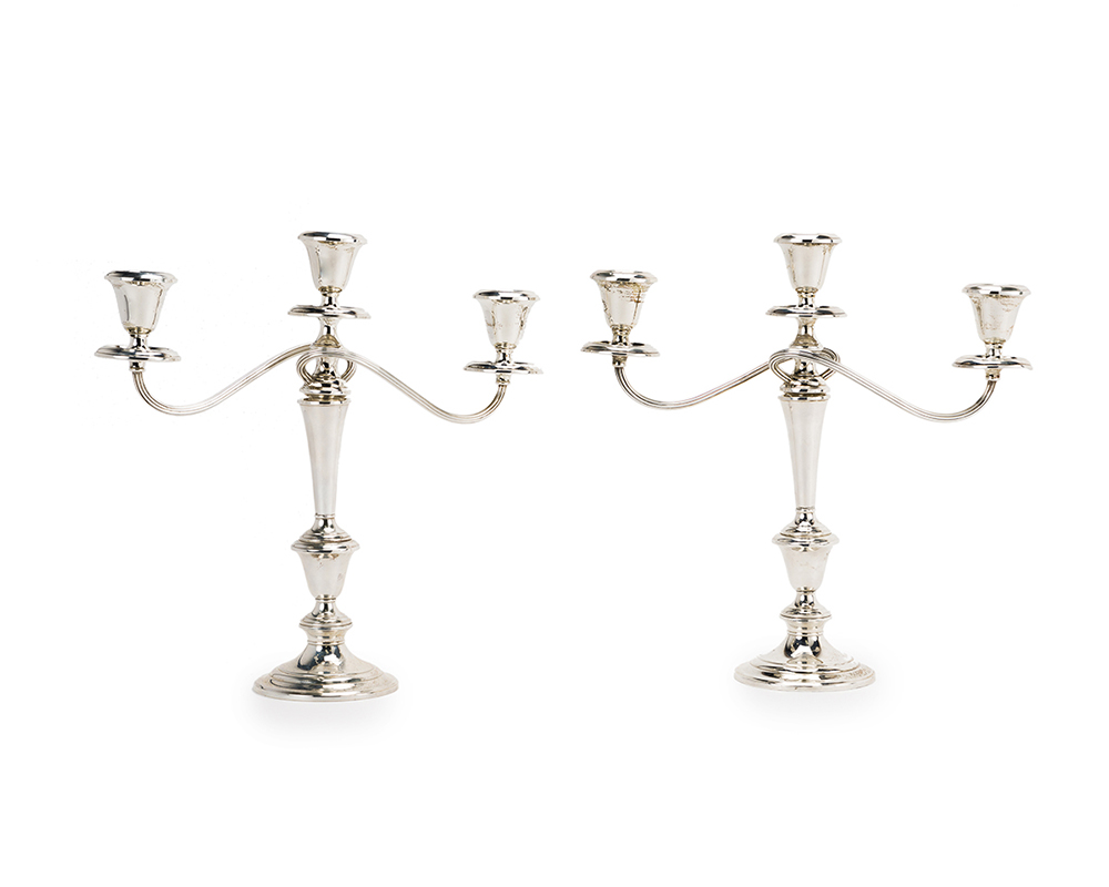 Lot 1103 - A pair of Gorham sterling silver convertible candlesticks