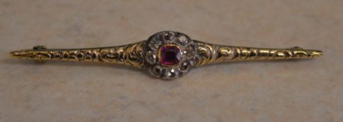 Tested as 18ct gold diamond and ruby bar brooch, total approx weight 4.