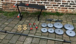 Barbells & dumbbells and an exercise bench.