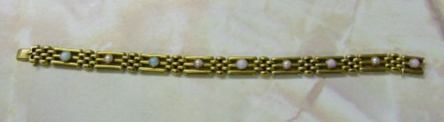 "Tested as 15ct gold gate bracelet with opals and seed pearls weight L 7"" weight 16."