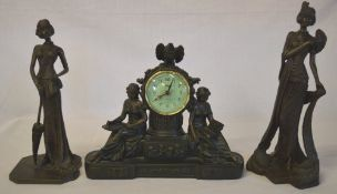 2 bronze effect figures and a figural clock