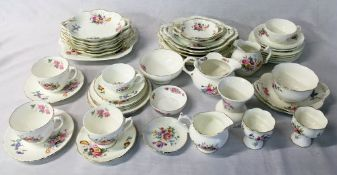 Large quantity of Coalport and similar Crescent table wear with floral design.