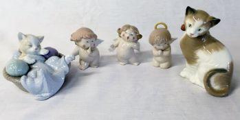 3 Nao cherubs and 2 Nao cat figures