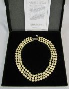 Franklin Mint 'Jackie's pearls' - boxed reproduction of the triple strand faux-pearl necklace owned