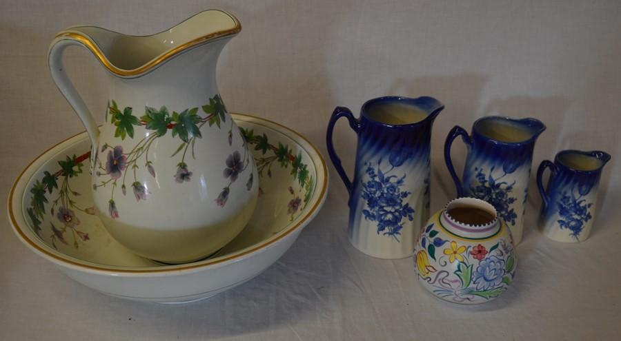 Lot 13 - Late Victorian wash bowl & jug, Poole Pottery vase & 3 graduated jugs