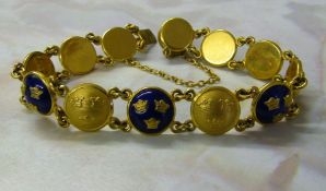 Swedish Sporrong enamelled bracelet designed as twelve circular panels each decorated with the three