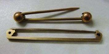 2 9ct gold pins (1 af) total weight 2.9 g