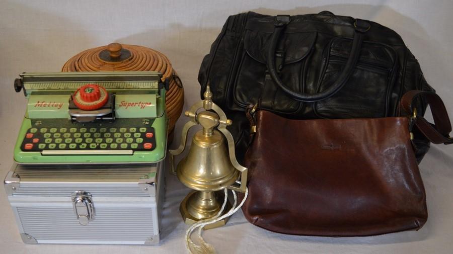 Lot 25 - Mettoy Supertype child's typewriter, 2 leather holdalls & handbag, brass bell etc