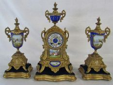 Continental gilt metal and porcelain clock with garniture complete with stands H 42 cm (missing