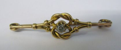 Tested as 15ct gold brooch with 0.10 ct diamond solitaire total weight 4.2 g