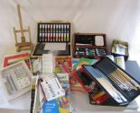 Lot 61 - Large collection of painting materials inc brushes, canvasses, paints and an easel