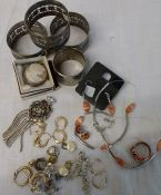 Selection of costume jewellery, silver pendant, napkin rings and cameo brooch