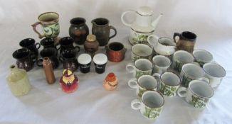 Selection of studio pottery & novelty pepper pots inc Guinness, Stan Laurel etc